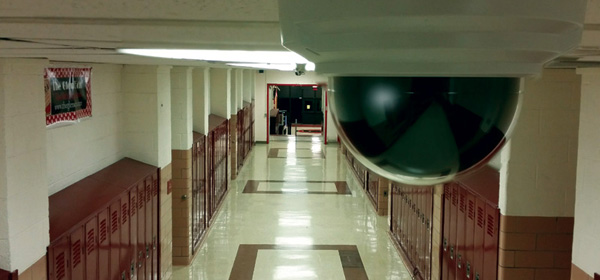 Security camera in school hallway